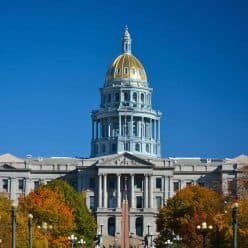 Colorado State Capitol dome in Denver with a blue sky.