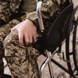 Close-up photo veteran in a wheelchair.