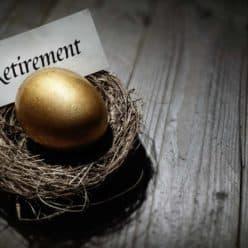 Golden egg in nest with sign reading retirement.