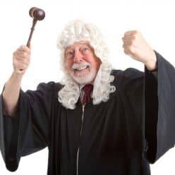 Angry judge shaking gavel