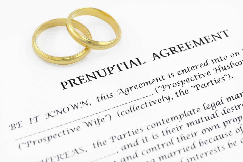 Wedding rings on top of prenuptial agreement