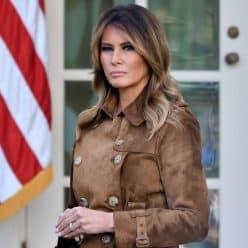 First Lady Melania Trump in front of American Flag