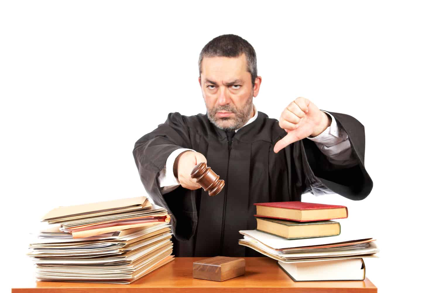 Judge with stack of books giving thumbs down