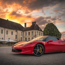 Fancy car & house.