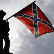 Statue of man with Confederate Flag